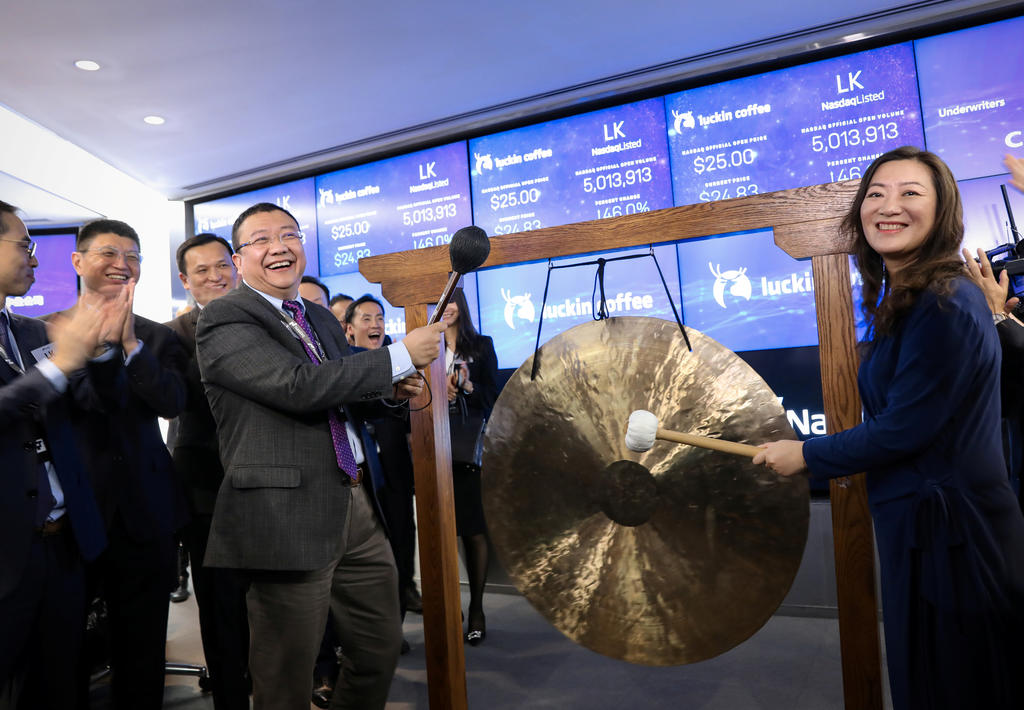 Jenny Qian Zhiya CEO of Luckin Coffee, and Charles Zhengyao Lu, non-executive chairman of Luckin Coffee, ring a ceremonial bell to celebrate trading of the company's stock during the IPO at the Nasdaq Market site in New York, U.S., May 17, 2019. REUTERS/Brendan McDermid