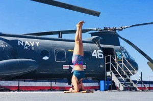 Doing  yoga at USS Midway museum for charity  benefit.
