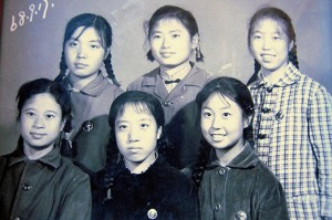 Jing with classmates before relocating to the countryside in 1968. Jing is right end of first row.