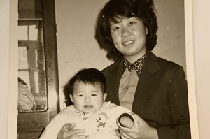 Jing with her one year old baby in 1983.
