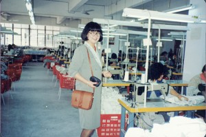 Jing as manager inspecting garment factory exporting to North American market in 1990.