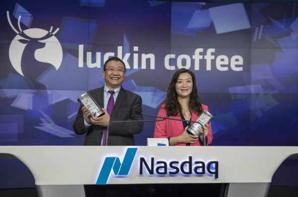 Jenny Qian Zhiya, chief executive officer of Luckin Coffee Inc., right, and Charles Zhengyao Lu, chairman and founder of Luckin Coffee Inc., stand for photographs before ringing the opening bell during the company's initial public offering (IPO) at the Nasdaq MarketSite in New York, U.S., on Friday, May 17, 2019. Luckin Coffee, a challenger to Starbucks Corp. in the race to dominate China's growing coffee culture, climbed in its trading debut after raising $561 million in an expanded U.S. initial public offering. Photographer: Victor J. Blue/Bloomberg via Getty Images